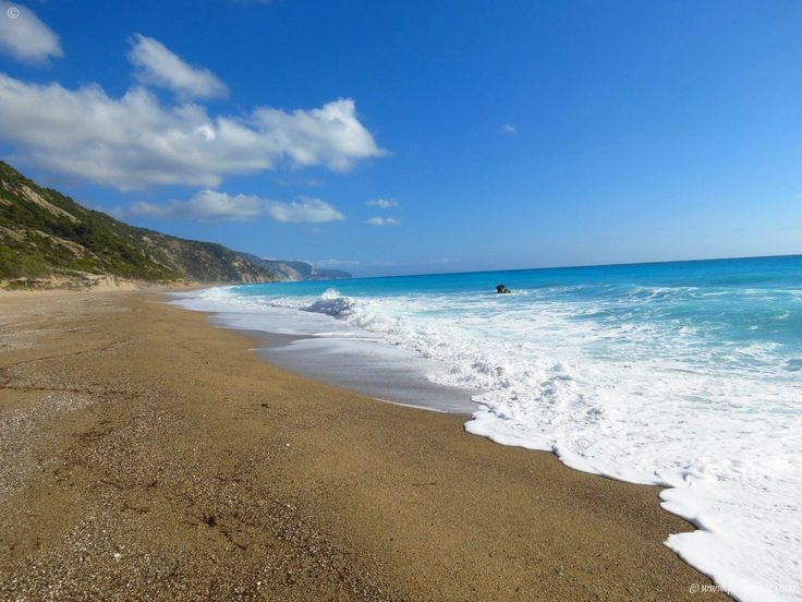 Waves and clouds at Gialos - the longest beach of Lefkada