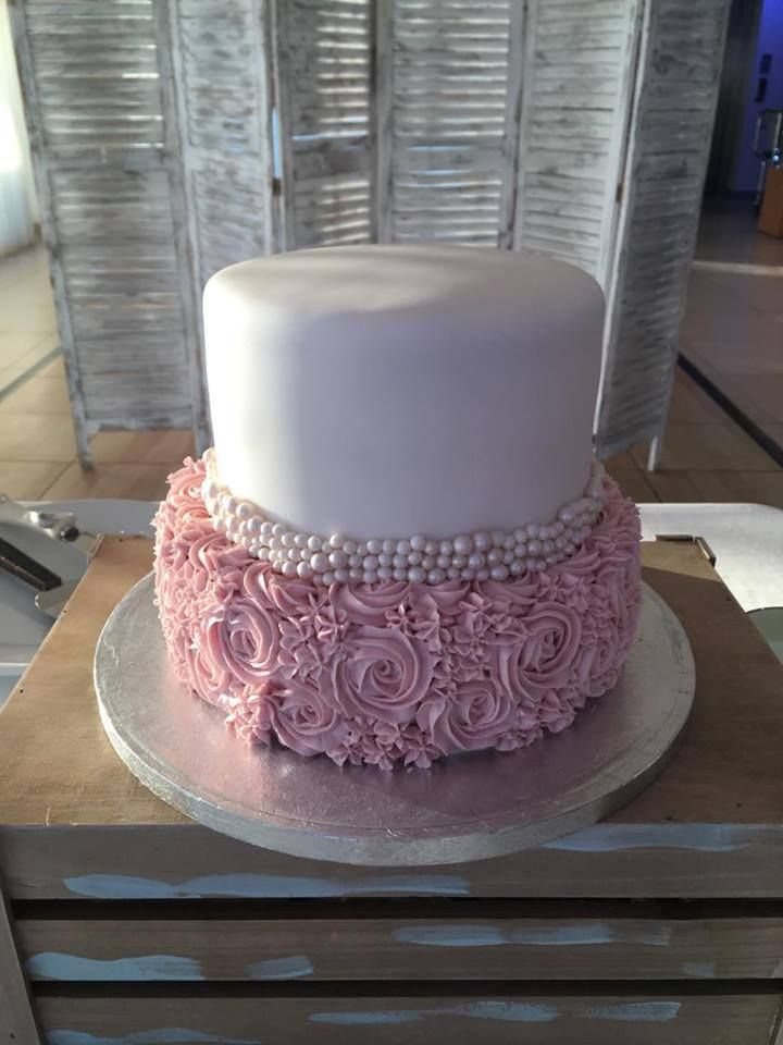 Gluten free wedding cake with buttercream, edible pearls and fondant