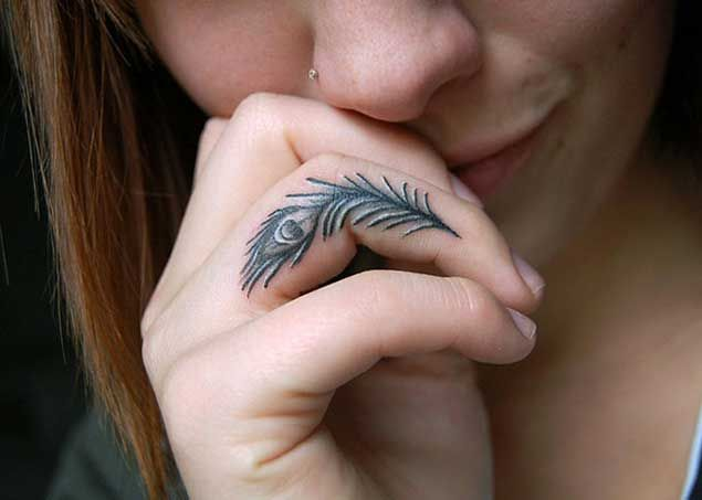 Peacock Feather Finger Tattoo