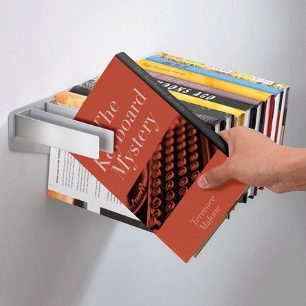 Coolest book shelf I've seen in a while...want so i can start mutliple books, hold my spot sans bookmark, and finish them as I please