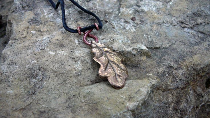Hand forged brass oak leaf pendant.