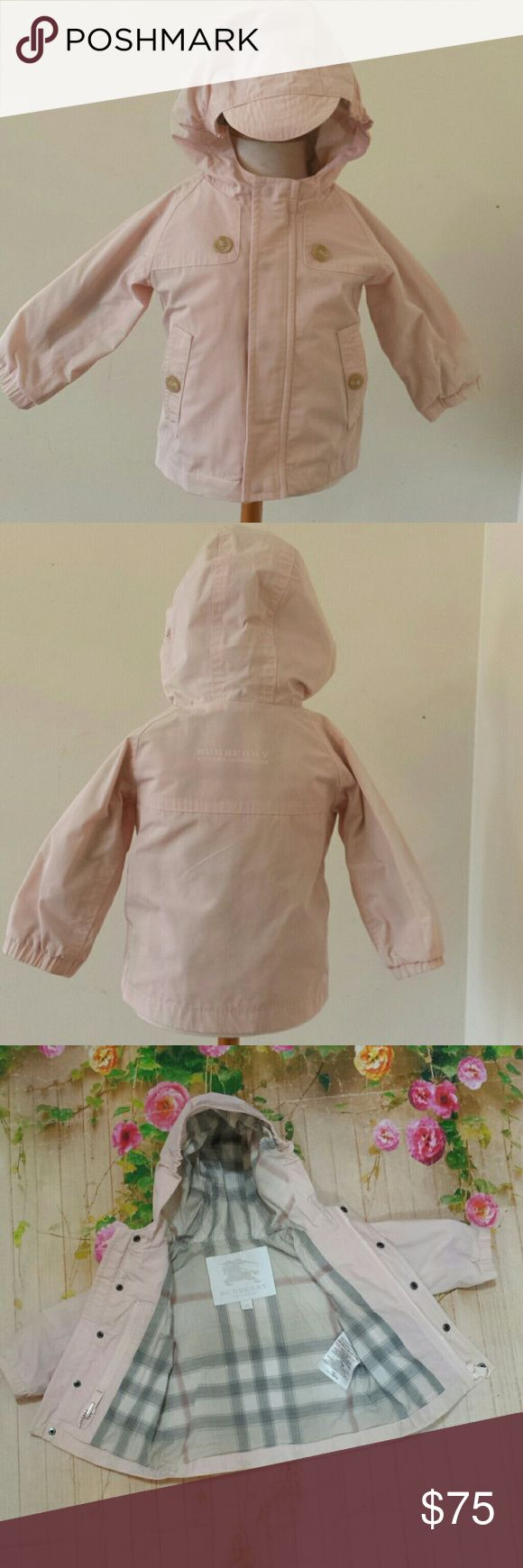 Burberry baby girl 6m pink light rain wind jacket Up for grabs: Burberry baby girl size 6 months lightweight jacket / windbreaker. (polyester) Pink with 'cap rim' hood. Light colored Burberry check plaid lining. (cotton) Zipper, snaps, pockets. Smoke-free pet-free home. Gently used with no flaws. Combine items and save on shipping! Contact me with any questions. Burberry Jackets & Coats Raincoats