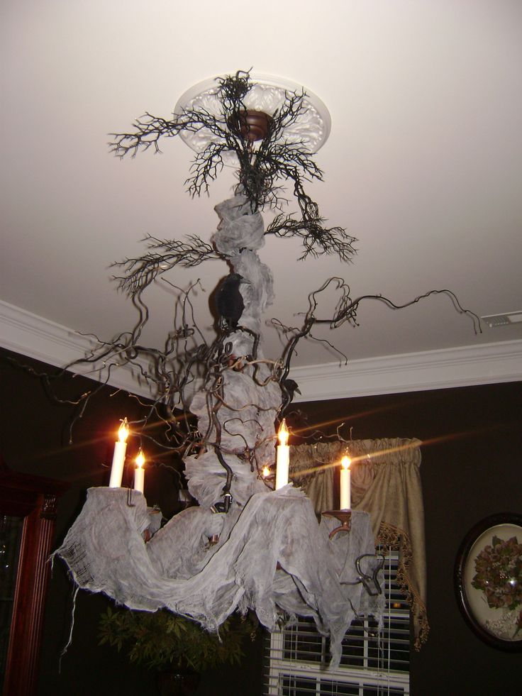 creepy halloween chandelier very cool cheesecloth dried branches spray painted black and some - Diy Spooky Halloween Decorations