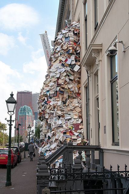 Book sculpture flows out of Meermanno Museum, The Hague. Alicia Martín, artist