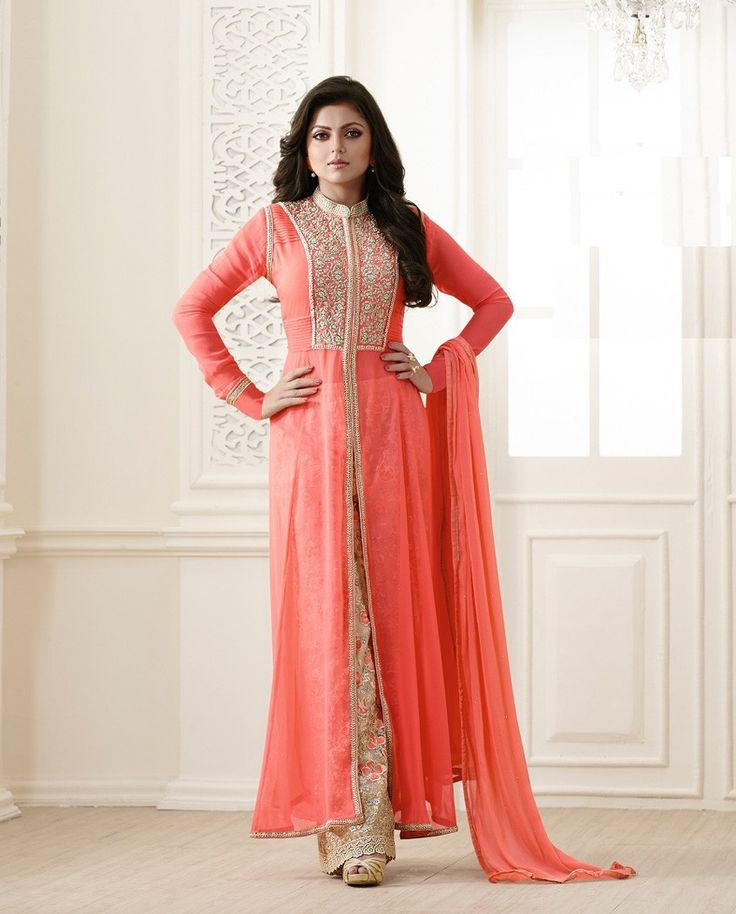 Light orange and beige front slit suit with embroidered yoke   1. Light orange and beige poly georgette front slit suit2. Floral embroidered palazzo3. Comes with matching santoon bottom and chiffon dupatta4. Can be stitched upto size 42 inches