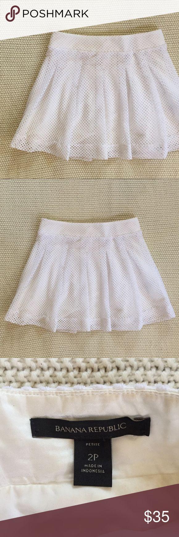 Banana Republic Skater Skirt White skater skirt with netting/mesh overlay. Zipper in back. 100% polyester. Length - 15 inches. Waist - 14 inches. Banana Republic Skirts Mini