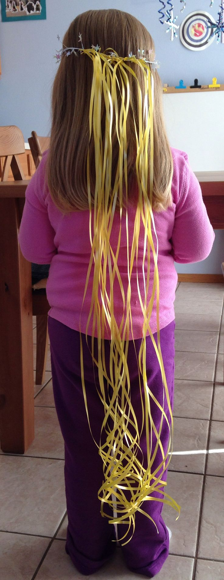Rapunzel Hair Craft - measure the child's head with wire garland then tie on pieces of yellow curling ribbon - Preschool Activity