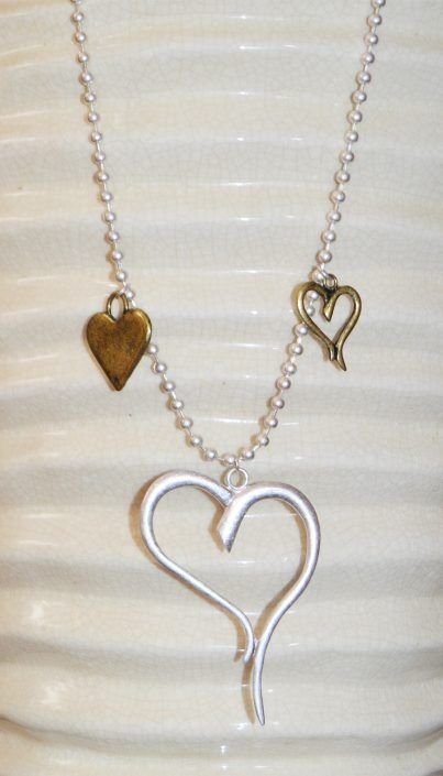 Multi Heart Pendant Necklace in All Matt Silver or Matt Silver Gold Finish This Multi Heart Pendant Necklace in All Matt Silver or Matt Silver Gold Finish is a beautiful necklace for any occasion. This is elegance for the modern woman. This superb necklace is available in two colours, all Matt Silver finish or a Matt Gold and Silver finish. A real must to show off any outfit.  This new season necklace is a great addition to any accessory wardrobe. £24.50