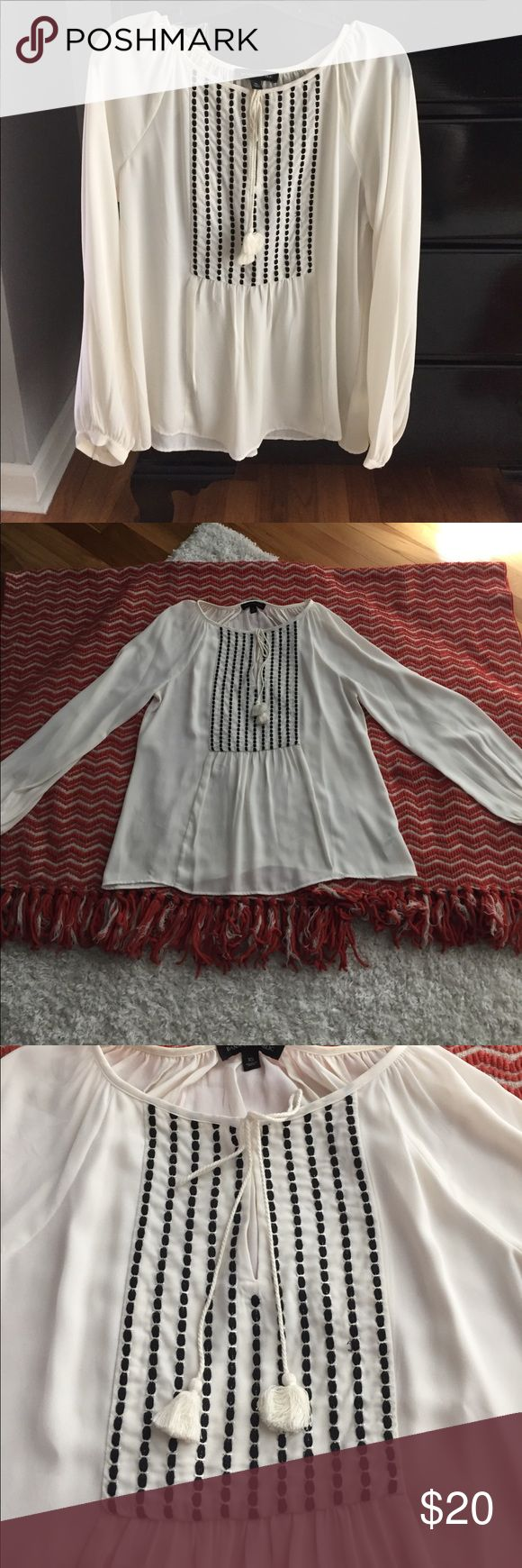 Banana Republic Dressy Top Selling a beautiful EUC dressy Banana Republic top in size XS. Shear cream color with black detail and tassel design on the front. Can wear a cream or nude cami underneath or a nude bra. 100% polyester. Smoke free home! Banana Republic Tops Blouses