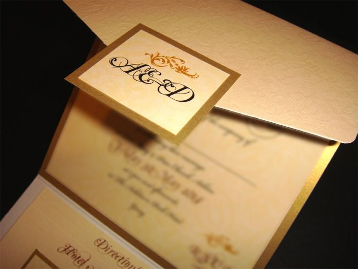 Ivory embossed pocketfold envelope matched with gold backing card and topped with an ivory insert.  www.justaddyou.ie