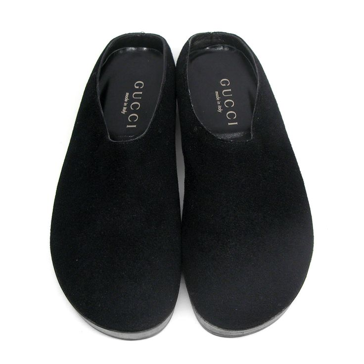 These Gucci slippers are a modern take on traditional clogs. The have been crafted in Italy from black felt, detailed with signature web detail on the back.Size: 45.Made in Italy.