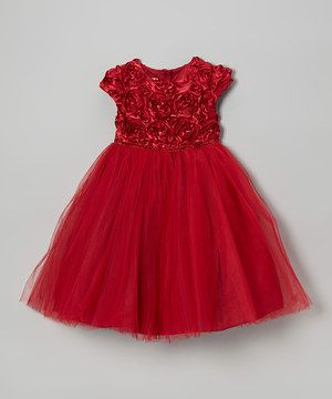 A rosette-bedecked bodice and generous tulle skirt make this dress a genuine stunner. Little ladies will look as sweet as a fresh bouquet when they slip into this elegant piece.