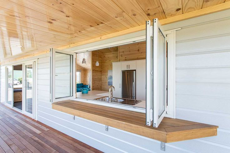 Bifold windows open from the kitchen to a large covered deck