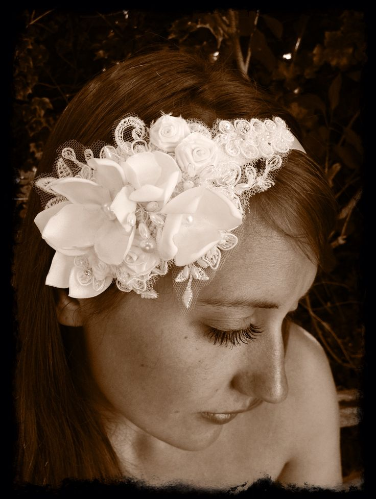 Hand stitched satin flower hair ribbon with beaded lace and added crystals and pearls.