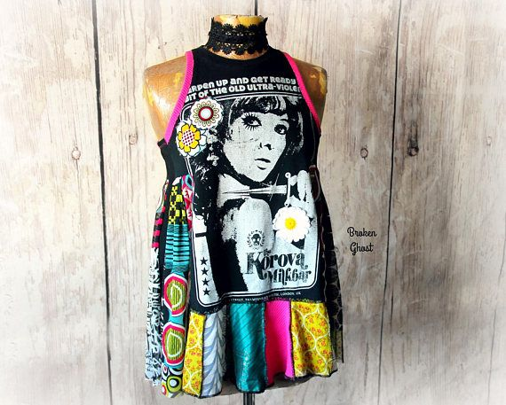 DEANNA Top  This one of a kind top was reconstructed from a London nightclub t-shirt featuring Twiggy. This is a high neck tank style with colorful accents in a mix of fabrics as well as flower appliques on the front. Womens size small/medium to medium Bust: will fit 34-37 inches