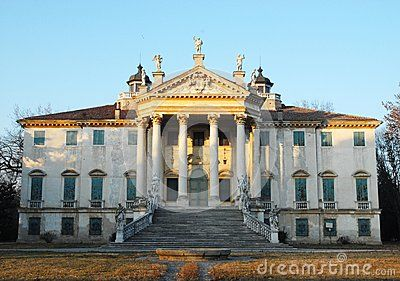 Photo taken, to Noventa Padovana in the province of Padua (Italy), the facade of the villa Giovanelli Colonna. The villa is located near the river Brenta that runs in front. Like almost all the villas of the Riviera del Brenta was commissioned by a noble Venetian exactly the patriarch Giovanni Maria Giovanelli. The picture shows the top of the beautiful facade, consisting of a staircase and columns, illuminated by the setting sun.