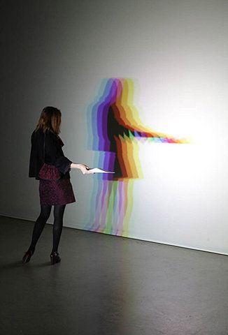 By Olafur Eliasson. It's real shadow, not faked in photoshop. each lamp is aligned differently.