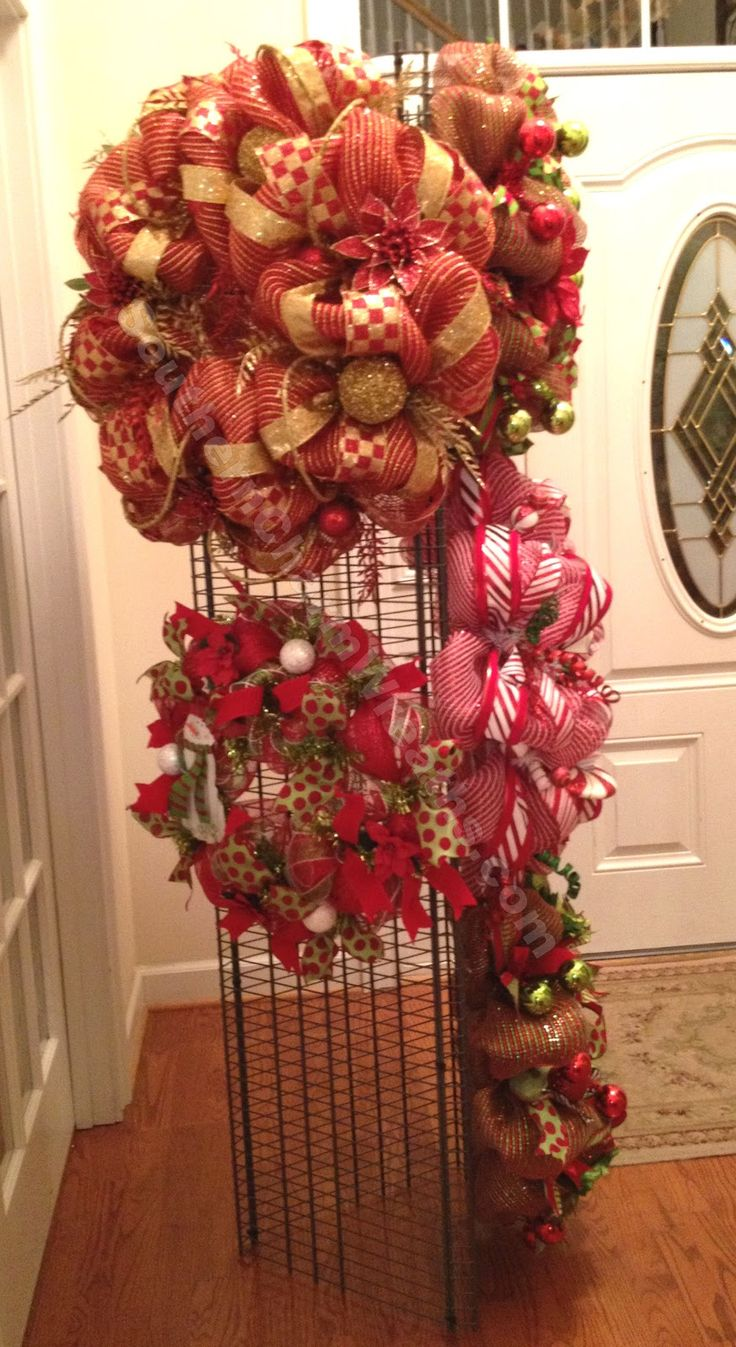 "How To Make A Wreath-Craft Show Display or Storage | Southern Charm Wreaths www.blog.southerncharmwreaths.com ------ 3 ClosetMaid 6' x 15.89"" Shelves. 15 Heavy Duty Cable Ties. ""S"" Hooks. This could work for my wristlets."