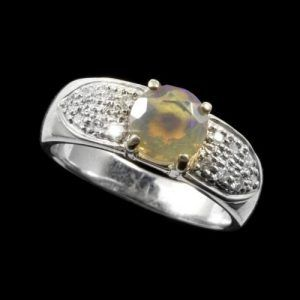 #Opal Ring 5431 Faceted amber crystal opal with grain set diamond clusters set in sterling silver. https://opalmine.com/product/opal-ring-12-3/