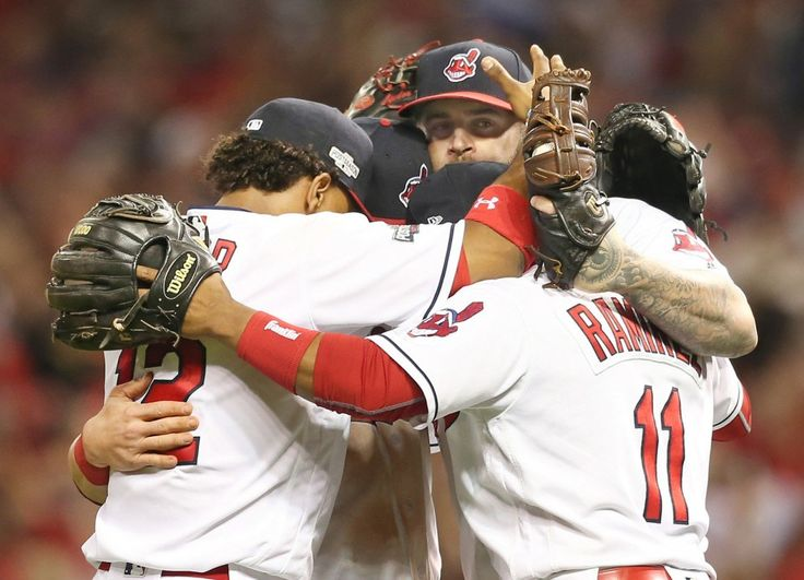 Cleveland Indians infield, Francisco Lindor, Jason Kipnis (behind), Mike Napoli (holding the last out of the game in his mitt) and Jose Ramirez have a group hug on the infield after defeating the Boston Red Sox 5-4 in the first ALDS game, on Oct. 6, 2016 at Progressive Field.  (Chuck Crow/The Plain Dealer)