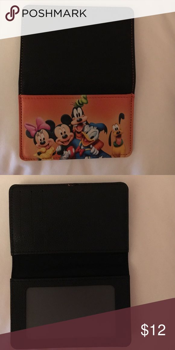 New all leather Disney credit/debit card holder. Three pockets. All leather. New never used. Accessories Key & Card Holders