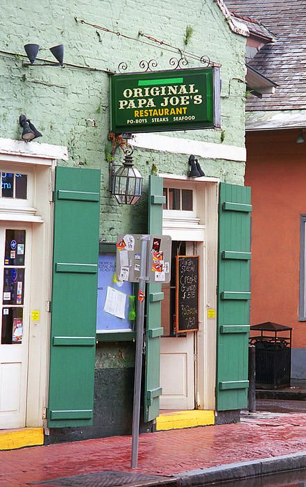 """New Orleans - Papa Joe's restaurant and bar on Bourbon Street. A fine example of the fading New Orleans architecture. """"The Fine Art Photography of Frank Romeo."""""""