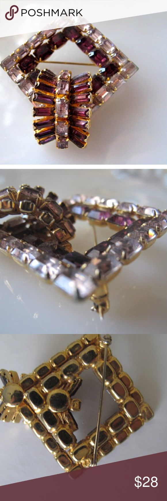 Mid Century Amethyst Rhinestone Brooch This unsigned beauty features lovely baguette prong set rhinestones in amethyst and clear. The setting is diamond shaped, or could be square.     One section in the corner has stones that are arranged in a three dimensional arc.     There is some darkening of the clear stones as one might expect from a brooch this age, but there is still plenty of bling left!    The brooch is very unusual distinctive. I haven't found another one like it. Vintage Jewelry…