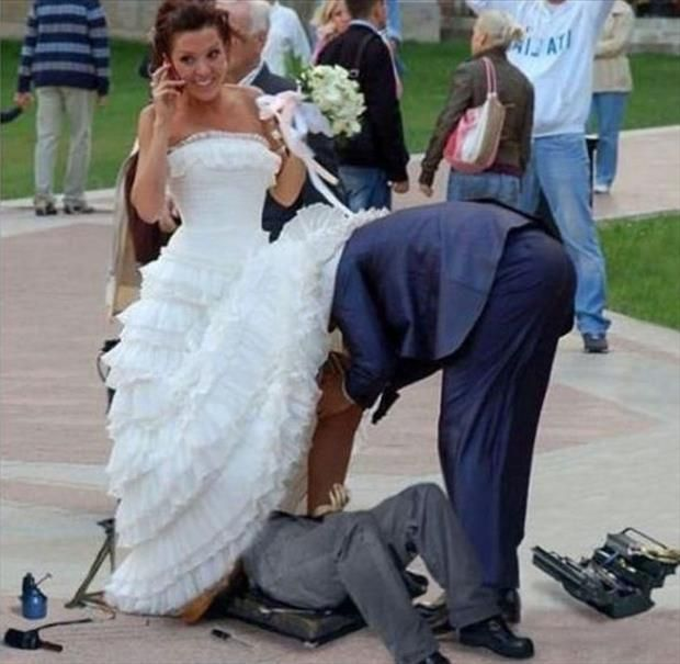 Funny Wedding Pictures Groom Taking Off Brides Garder