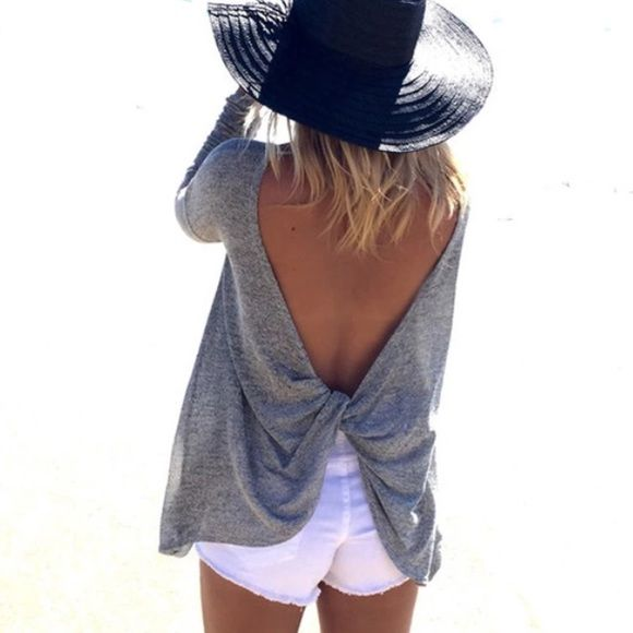 Super cute long sleeve shirt. Has a very sexy open back. Fits losely. Made out of very comfortable cotton and polyester material. It is a light gray shirt.