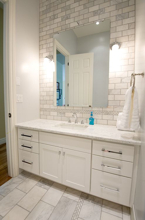 fantastic bathroom remodel with extra wide single white bathroom vanity with marble countertop pale blue walls paint color marble subway tiles backsplash
