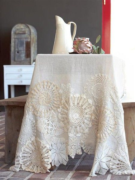 LOVE THIS!  Grandmas old doiles with new linen table cloth.  Love it! Stitch Doilies onto Table cloth, embellish with buttons, ribbon, embroidery - inspired! - May have to think about this. Found LOTS of doilies at the house and cant bring myself to toss them.