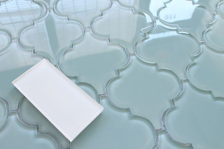 Bring a touch of elegance to your new new kitchen backsplash or bathroom with our Jasper Arabesque Glass Tiles. These tiles are stunning! The color is a blue gray with...