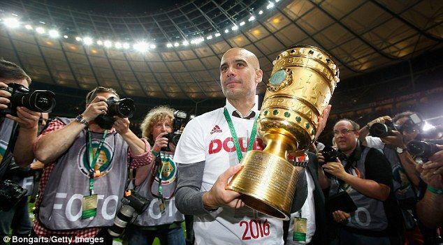 Guardiola celebrates lifting the DFB-Pokal with Bayern Munich last season