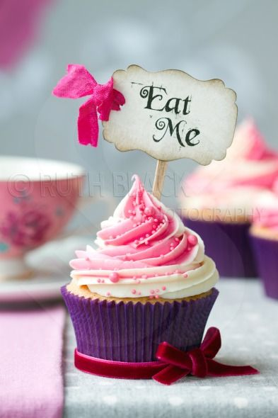 """Cupcake with """"Eat Me"""" pick - Royalty Free Stock Photo"""
