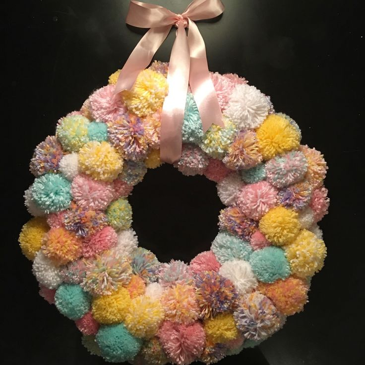 Pom pom wreath, easter wreath, modern easter wreath, spring wreath, nursery wreath, pastel wreath, baby girl wreath, modern spring wreath by ThePinkGardenias on Etsy https://www.etsy.com/listing/265185931/pom-pom-wreath-easter-wreath-modern