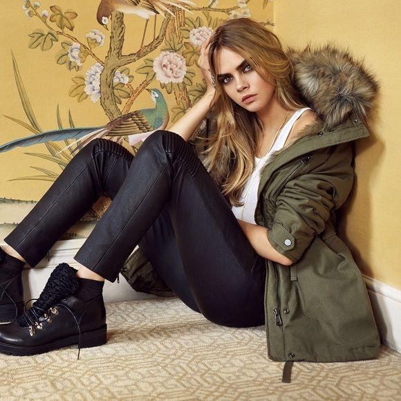Topshop Parka Topshop oversized faux fur trimmed parka in khaki.  Previously worn. Good condition! As seen in the Cara a Delevigne campaign.  This coat is extremely warm and very cute! Topshop Jackets & Coats