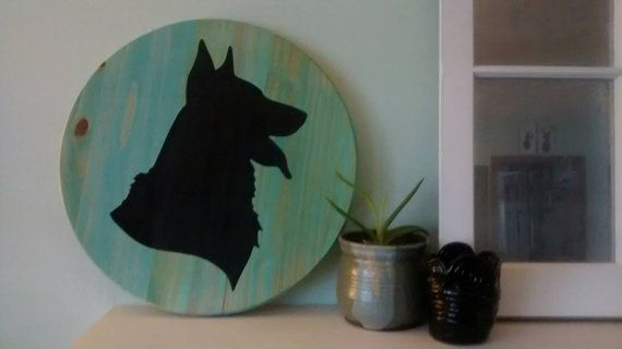 """Custom dog silhouette portrait. Solid wood round by RusticityGoods Add a pop of color to any room with this adorable, solid wood painting. It can be made in any color and most dog breeds.Names can be added as well. Message me with custom requests. The sign measures 18"""" diameter and is a little over an inch thick. Tags: Affenpinscher, Afghan Hound , Airedale Terrier , Akita ,Alaskan Malamute ,American English Coonhound, American Eskimo Dog, American Foxhound, American Staffordshire Terrier…"""