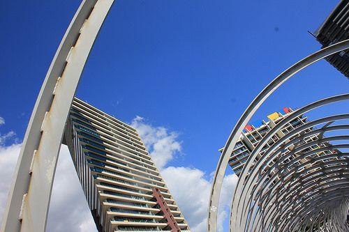 Skewed city views-Peeting through the Webb Bridge in Docklands on a beautiful blue sky day in Melbourne.