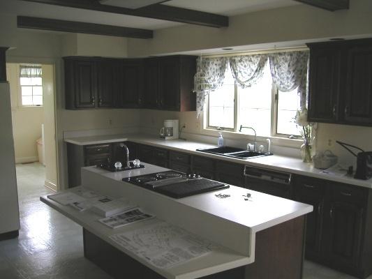 Current kitchen white countertops cherry cabinets not for Dark linoleum flooring