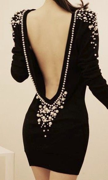 Pearly backless cocktail dress, just wish I had some place to go where I could dress like this. With a handsome suited gentleman I must add