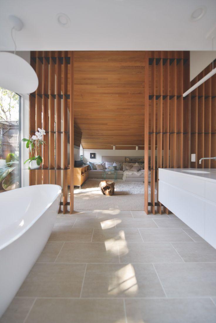 an ensuite bathroom renovation with warm fir wood slat