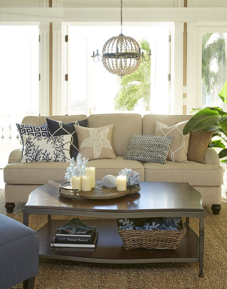 This neutral sofa is perfect paired with blues and other neutrals for a beachy vibe!