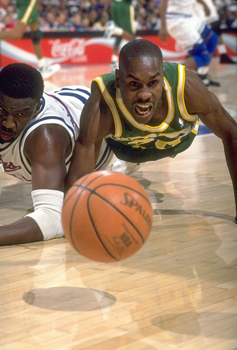 """Supersonics guard Gary Payton dives for a loose ball against the Sacramento Kings.  """"The Glove"""" was known for his superb defensive abilities and his hustle on the court.#Seattle #SuperSonics #NBA"""