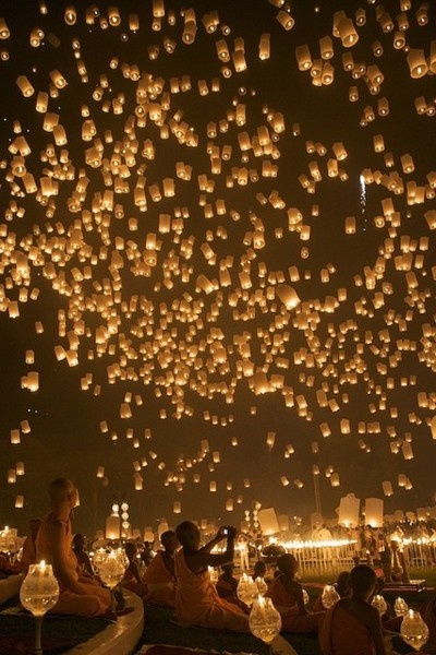 Wedding Flying Paper Lanterns- Each guest gets to tie a tag on a lantern with a wish for the couple and releases them when the couple leaves.