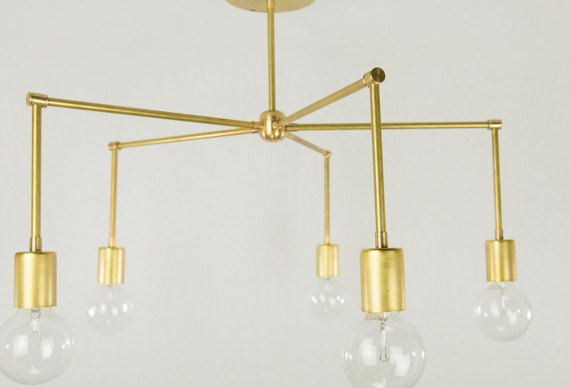 This is a beautiful modern brass light fixture perfect for a dining room, office, or family room. 5 bulbs project wonderful light to an entire room.