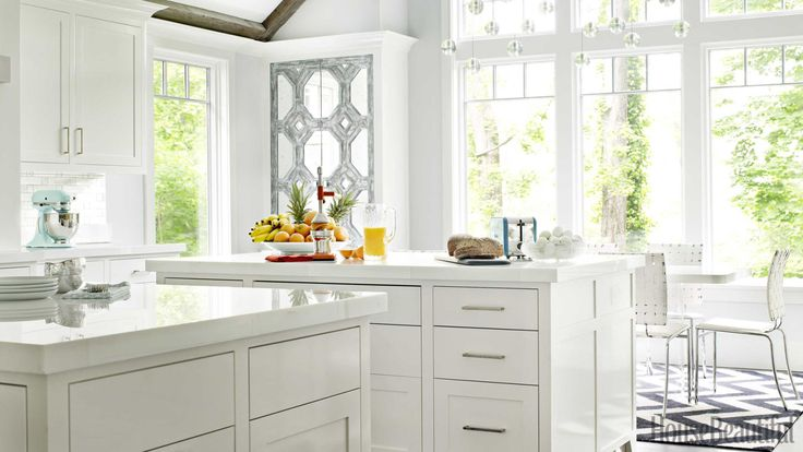 These whites are not only clean, they sparkle. Custom cabinetry in Benjamin Moore's high-gloss Super White is topped with counters made of crystallized glass by Glassos. Chandelier by Bocci.   - Veranda.com