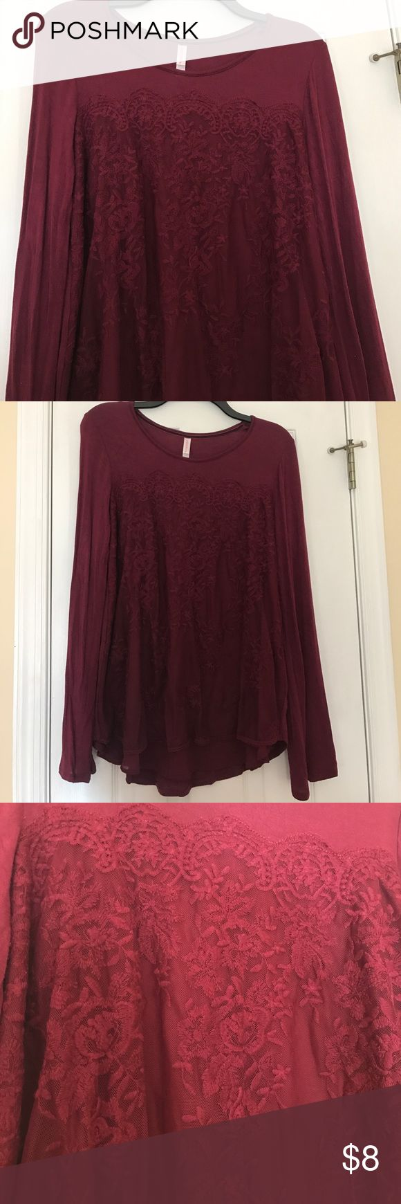 Women's xhilaration maroon top Super cute and soft maroon top by xhilaration (target), juniors size large. Long sleeved shirt with slight bell of sleeve (by wrist). The shirt has a very cute floral design on the front with cute and elegant trim along bottom of shirt. Only worn once. Smoke free home! Xhilaration Tops Blouses