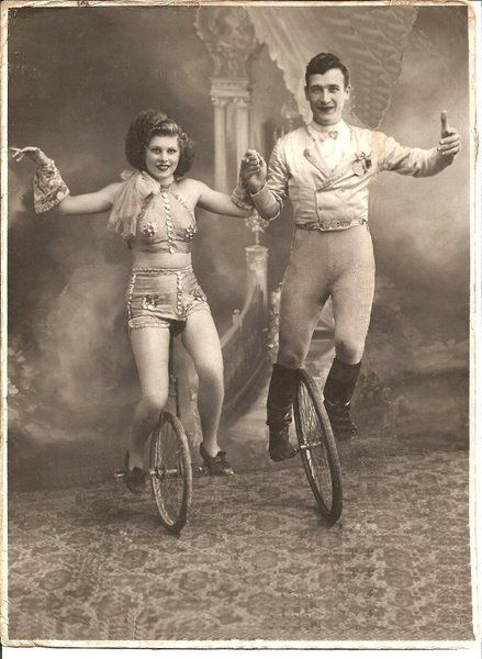 The man's unicycle has no seat! Two vintage unicycles performers posing for a studio portrait. #vintage #circus #performers