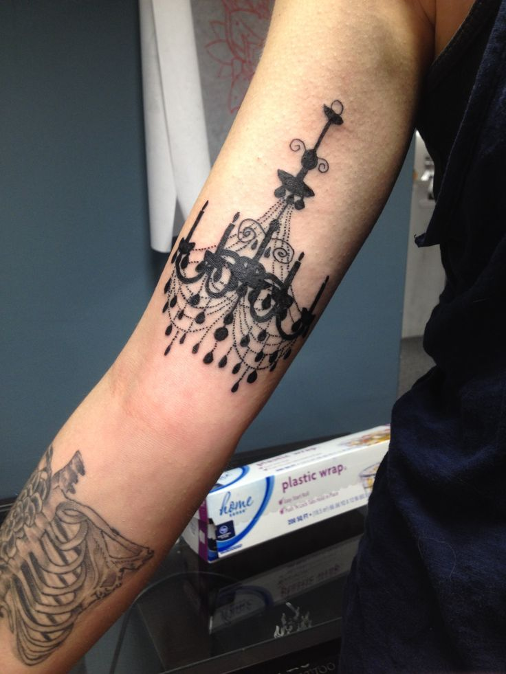 Chandelier silhouette tattoo. These thin lines will bleed together something awful, but it looks great right now!