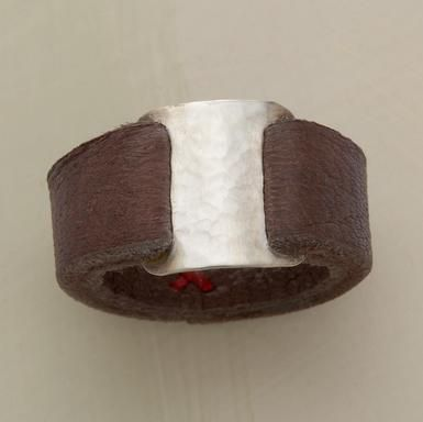 """Leather this supple is a rare find. Ours loops through both sides of a rectangular tab of hammered sterling and joins with three tiny red stitches beneath the finger. Handcrafted in USA by Renee Garvey. Whole sizes 5 to 9. 3/8""""W."""